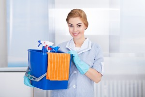 Happy Young Maid Holding Bucket With Cleaning Supplies